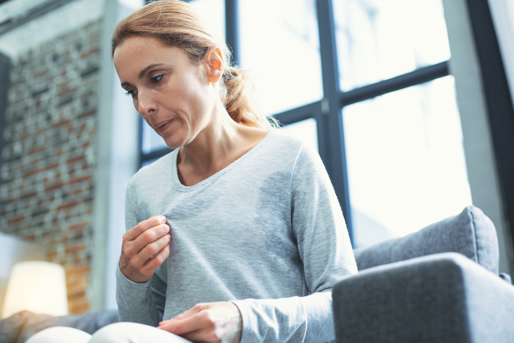 Woman having hot flashes during menopause